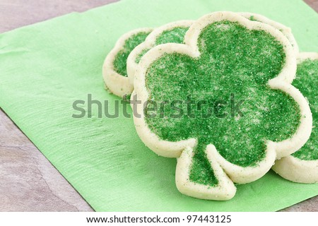 Freshly baked St. Patrick's Day sugar cookies on a green napkin. - stock photo