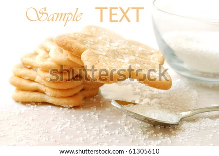 Freshly baked star shaped sugar cookies with decorating sugar on white background with copy space.  Macro with shallow dof. - stock photo
