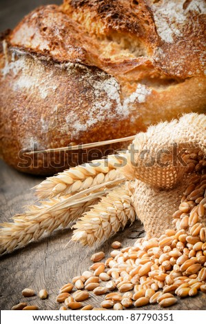 Freshly baked traditional bread in countryside setting - stock photo