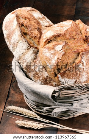 Freshly baked traditional bread in the basket - stock photo