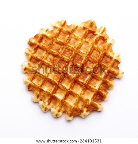 Freshly baked waffle isolated on white background. Top view. - stock photo