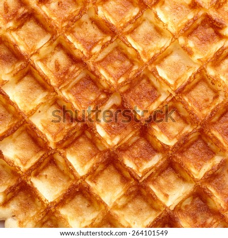 Freshly baked waffle texture. Top view. - stock photo