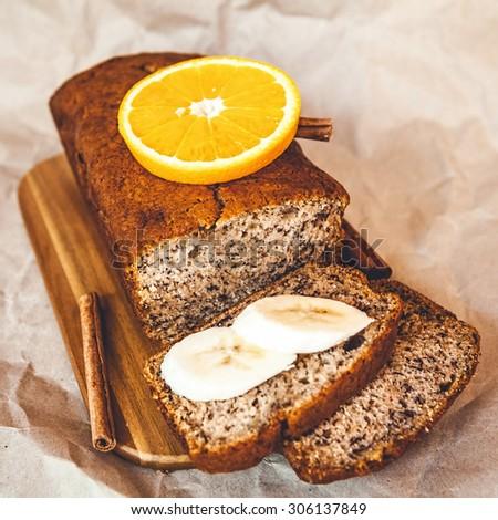 Freshly banana bread with banana and orange - stock photo