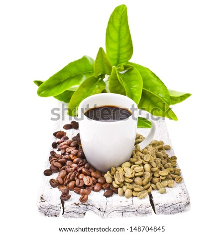 freshly brewed black coffee in a white cup and grain unground coffee on white boards isolated on white background - stock photo