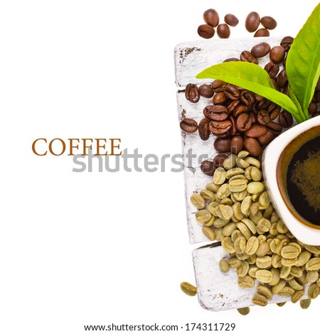 Freshly brewed black coffee in a white cup with coffee beans on a white board, with space for your copy on the left. - stock photo