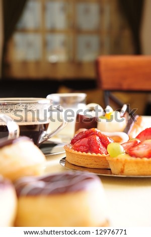 Freshly brewed coffee with a selection of cakes and confectionery.