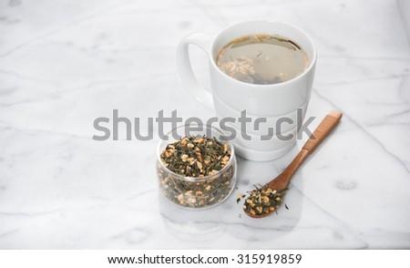 Freshly Brewed Cup of Genmaicha Green Tea - stock photo