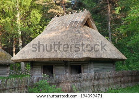 Freshly build thatched roof of old farm house (roof made of reed straws) - stock photo