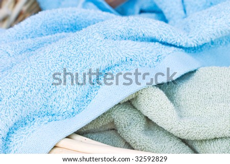 Freshly cleaned towels in a laundry basket