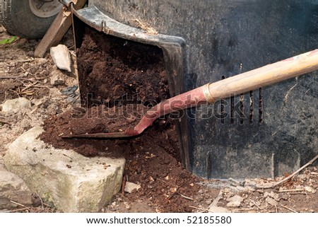 freshly composted earth from compost bin. nutrient rich vegetables converted to soil. - stock photo