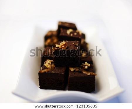 Freshly cooked brownies on a white place - stock photo