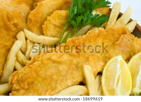 Freshly cooked Fish and Chips with Potato Cakes - stock photo