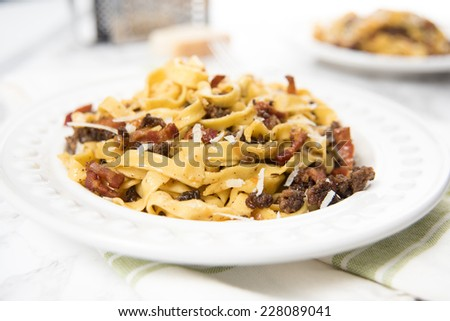 Freshly Cooked Homemade Fettuccine Pasta Served with Ground Beef and Parmesan - stock photo