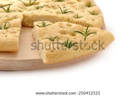 Freshly cooked Italian rosemary Focaccia bread. - stock photo