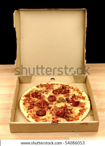 Freshly cooked takeaway pizza on a kitchen bench