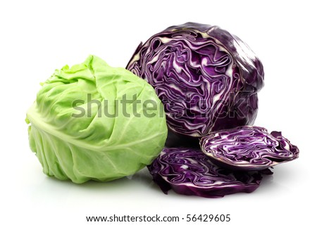 Freshly cut red and white cabbage on a white background - stock photo