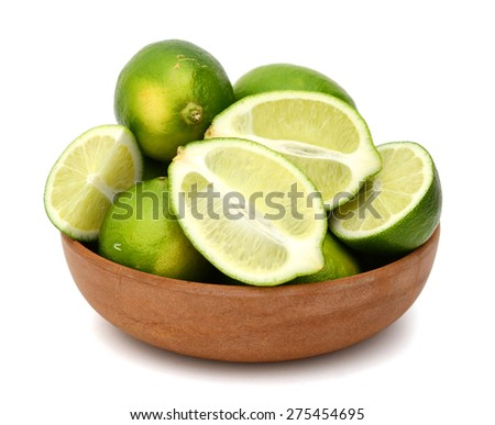freshly green limes in bowl isolated on white  - stock photo