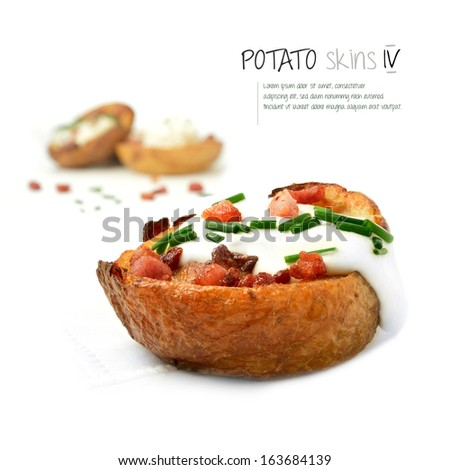 Freshly grilled bacon and cheddar cheese potato skins ozzing with soured cream against white. The perfect image for a bistro or restaurant menu and advertisement. Copy space. - stock photo