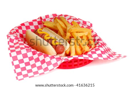 Freshly grilled hot dog with mustard and french fries in a serving basket - stock photo