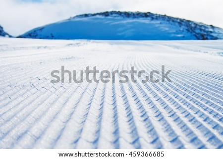 Freshly groomed ski slope in Moelltal Glacier ski resort, Austria. - stock photo
