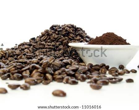 Freshly ground dark roasted coffee - stock photo