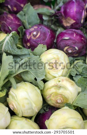 freshly harvested and cut turnip cabbage or kohlrabi at farmers market in Vancouver, BC