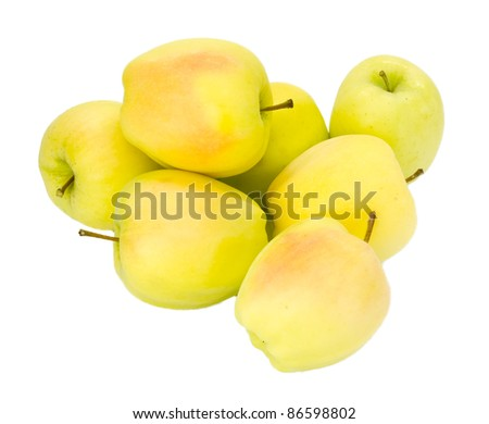 Freshly harvested Golden Delicious apples on isolated on white - stock photo