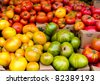 Freshly harvested heirloom tomatoes on display at the farmer's market - stock photo