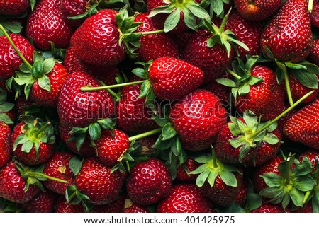 Freshly harvested ripe strawberries, top view. Wallpaper, texture and background - stock photo