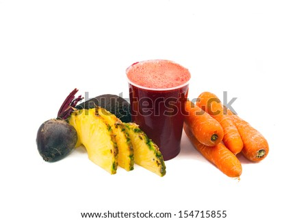 Freshly Juiced Fruit and Vegetables, consisting of beetroot,pineapple,carrots, and avocado.