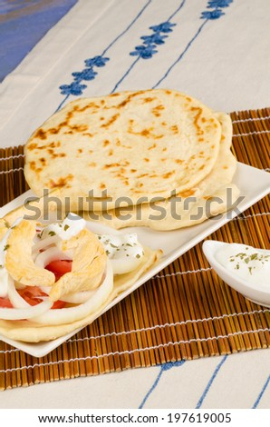 Freshly made chicken gyros with pita bread - stock photo