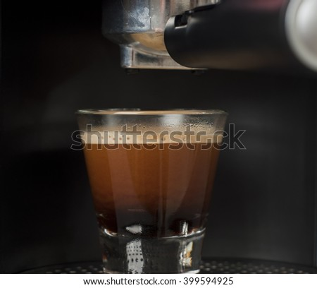 freshly made espresso still sitting in the espresso machine