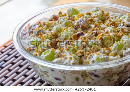 Freshly made grape salad with walnuts and brown sugar sprinkled on top - stock photo