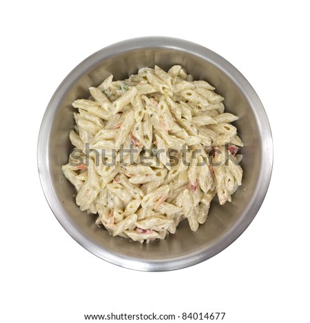 Freshly made Italian flavored pasta in a stainless steel bowl on a white background. - stock photo