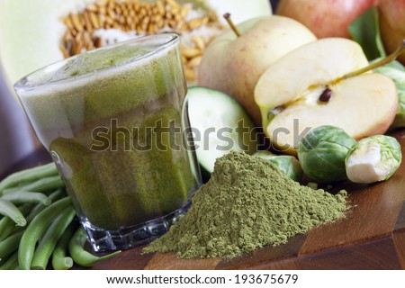 Freshly Made Juice With Organic Greens And Spirulina, Detox Cleanse, Liquid Diet And Healthy Living Concept Photography    - stock photo