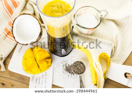 Freshly made mango banana smoothie with chia seeds.