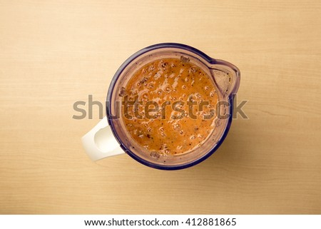 Freshly made mango, dragon fruit and tomato and blender, clean food, view from above - stock photo