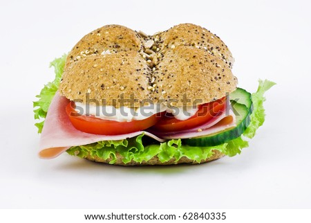 Freshly made sandwich with ham and vegetables - isolated - stock photo