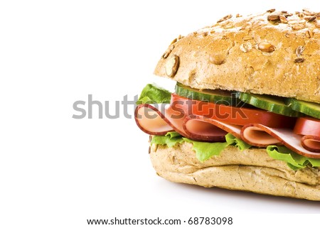 Freshly made sandwich with ham and vegetables over white - stock photo