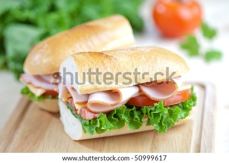 Freshly made sandwich with lettuce tomato and meat - stock photo