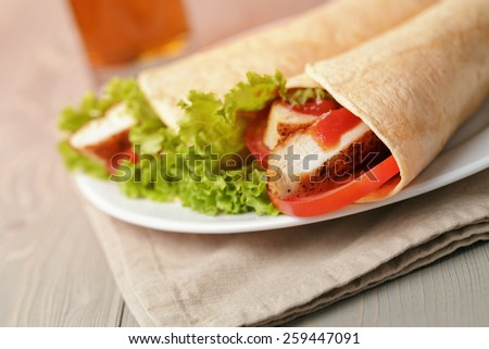 freshly made tortilla wraps with chicken and vegetables