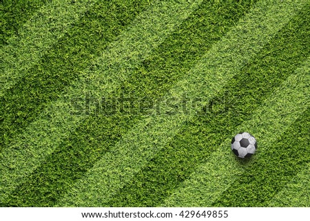 Freshly mown soccer field with soccer ball background.