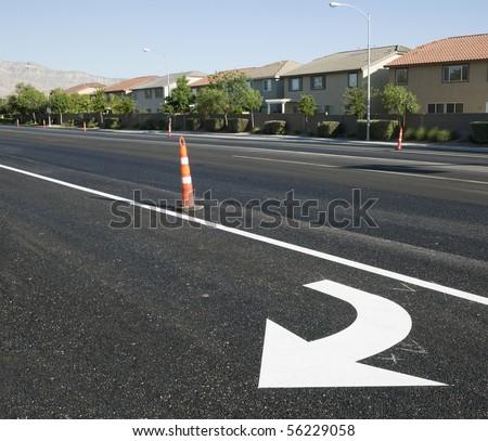 Freshly paved turn lane marker - stock photo