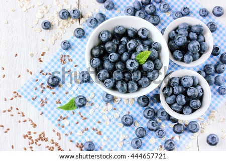 Freshly picked blueberries on white table top view - stock photo