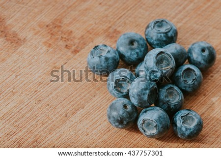 freshly picked blueberries on wooden table, juicy and fresh blueberry - stock photo