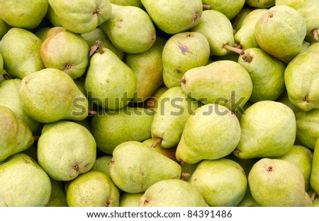 Freshly picked green Bartlett pears on display at the farmer's market - stock photo