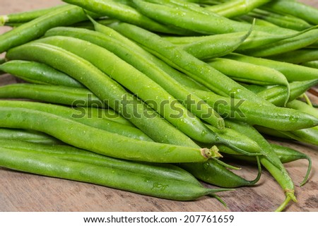 Freshly picked green or snap beans on a wooden table
