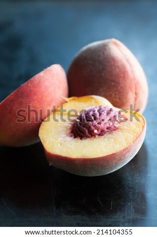 Freshly picked home grown ripe juicy peaches - stock photo