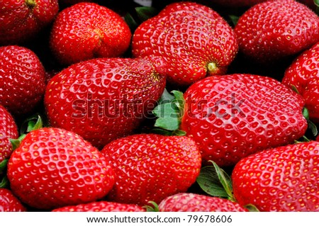 Freshly picked strawberry. Food background.
