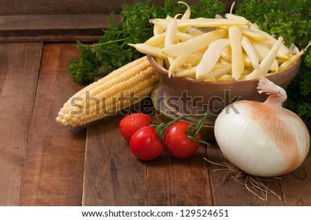 Freshly Picked Various Vegetables on Rustic, Weathered Wood Background - stock photo